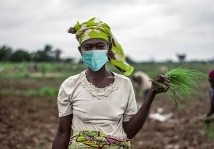 African-Woman-Farmer-with-mask
